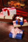 Christmas gifts near fireplace Stock Photos