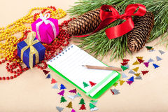 Christmas gifts, note pad, pencil and spruce branches Royalty Free Stock Image