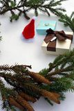 Christmas gifts and notebook lying near green spruce branch on black background top view. Space for text royalty free stock photos
