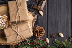 Christmas gifts on black wooden background Stock Photography