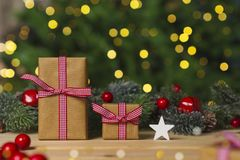 Christmas  gifts on table , christmas tree background Stock Images