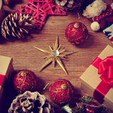 Christmas gifts and ornaments on a rustic wooden table Royalty Free Stock Photos