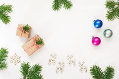 Christmas gifts and ornaments on a white stock photos