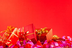 Christmas gifts over red Royalty Free Stock Photography