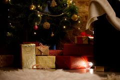 Christmas gifts under the tree Stock Photos