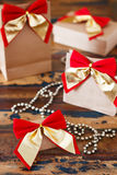 Christmas gifts paper package with red golden bow Stock Photo