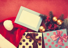 Christmas gifts and photo frame Stock Images