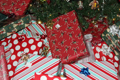 Christmas gifts. Are piled high under the tree on Christmas eve Stock Image