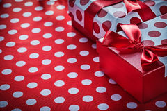 Christmas gifts on polka-dot red textile celebrations concept Royalty Free Stock Photos