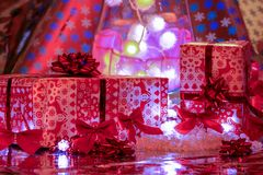 Christmas gifts posed in front of colorful illuminations royalty free stock image