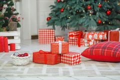 Present boxes under fir-tree Stock Photo