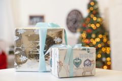 Present boxes under fir-tree Royalty Free Stock Image