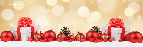 Christmas gifts presents balls banner decoration golden backgrou. Nd copyspace copy space text Stock Photography