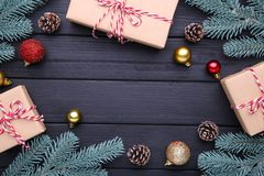Christmas gifts presents with decorations on a black background. royalty free stock images