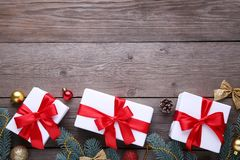 Christmas gifts presents with decorations on a grey background. royalty free stock image