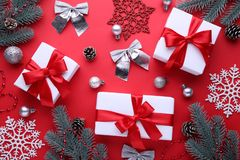 Christmas gifts presents with decorations on a red background. royalty free stock photos