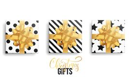 Christmas gifts. Realistic gift packages with gold bows and trendy winter patterns.  Royalty Free Stock Photography