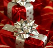 Christmas gifts on red Stock Images