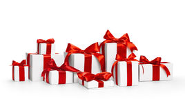 Christmas gifts with red bows. Christmas gifts with red ribbons isolated on white Royalty Free Stock Photo