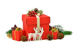 Christmas gifts in red boxes. Wooden deer handmade. Isolation. D Stock Image