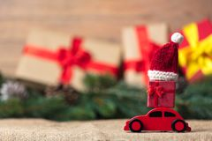 Christmas gifts and red car toy. With Santa Claus hat royalty free stock photography