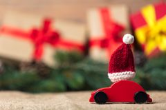 Christmas gifts and red car toy. With Santa Claus hat Stock Photography