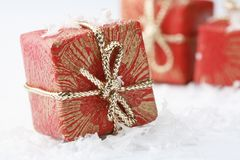 Christmas gifts with red wrapping and bows. Royalty Free Stock Photos