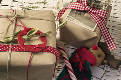 Christmas gifts, retro decoration, stars and red ribbons,. Wrapped in craft paper Stock Photos