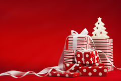 Christmas Gifts. With ribbon on a red background Stock Image