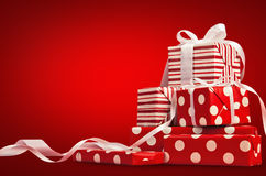 Christmas Gifts. With ribbon on a red background Royalty Free Stock Photography