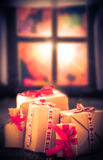 Christmas gifts rustic table window Outside window already getti Stock Photography