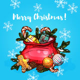 Christmas gifts in santa bag greeting card design. Christmas gifts in santa bag festive card. Present box with bow, candy cane and ginger cookie man in red bag Royalty Free Stock Photos