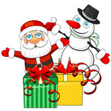Christmas gifts and Santa Claus with snowman Royalty Free Stock Image