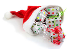 Christmas gifts in a Santa hat Stock Photos
