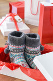 Christmas gifts and shopping bags on wooden floor Royalty Free Stock Image