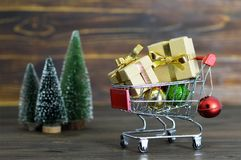 Christmas gifts in shopping cart Royalty Free Stock Image
