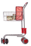 Christmas gifts in shopping trolley. Studio cutout Stock Photo
