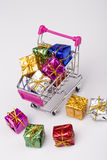 Christmas gifts in shopping trolley, isolated on white Royalty Free Stock Image