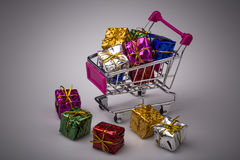 Christmas gifts in shopping trolley, isolated on white Stock Images