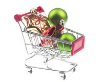 Christmas gifts in shopping trolley, isolated on white Stock Photography