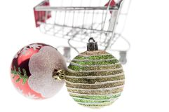 Christmas gifts in shopping trolley, isolated on white Royalty Free Stock Photos