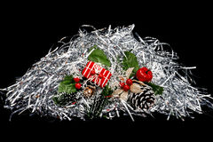 Christmas gifts with silver serpentine. On a black background Stock Image