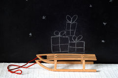 Christmas gifts on the sled abstract on blackboard Stock Images