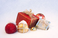 Christmas gifts on snow stock images