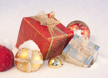 Christmas gifts on snow Royalty Free Stock Photos