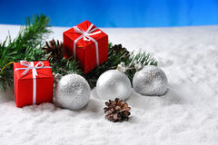 christmas  gifts on snow Stock Photos