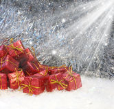 Christmas gifts in snow Royalty Free Stock Image