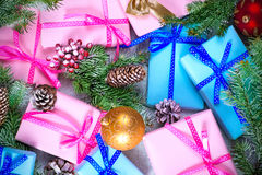 Christmas gifts and snow-covered fir-tree branches Stock Photo