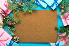 Christmas gifts and snow-covered fir-tree branches with copyspac Stock Photography