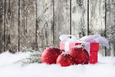 Christmas gifts in snow Stock Photos